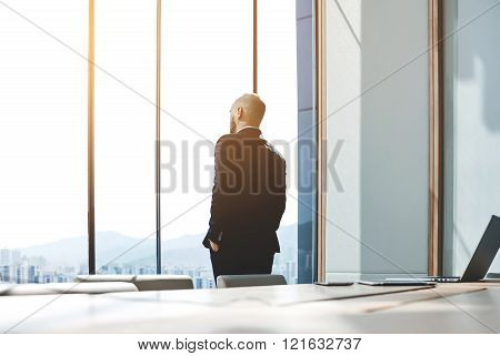 Successful businessman is thinking about future meeting with partners