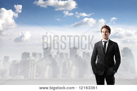 Smiling businessman with cityscape on the background