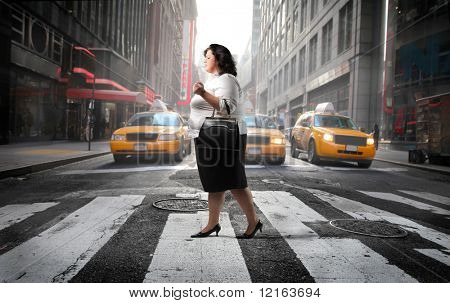 Fat woman crossing a city street