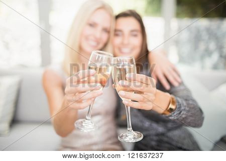 Beautiful women smiling and toasting champagne flute