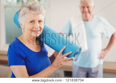 Senior woman smiling while packing up after workout