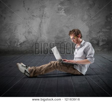 Young hacker using a laptop