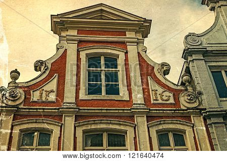 Old picture with architectural facade detail at one old building placed in Bruges Belgium dated 1716. Vintage processing.