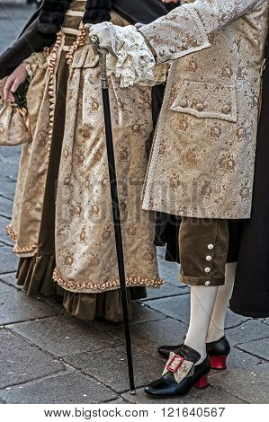 People on the street in Venice dressed in period costumes for the carnival.