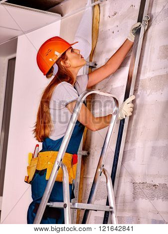 Happy woman in builder uniform indoor. Workplace Builder.