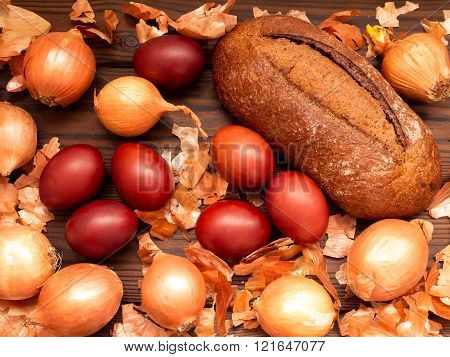Red Colored Easter Eggs And Homemade Bread