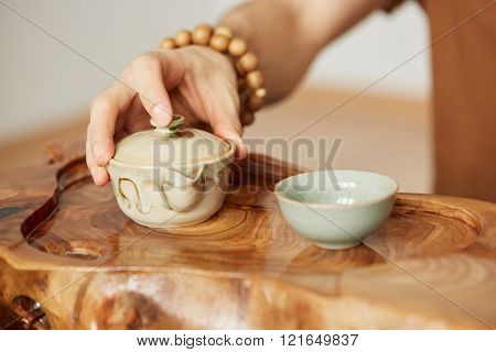 Chinese Tea Ceremony. Close-up Wooden Table For The Tea Ceremony Utensils On Tea Master Background A