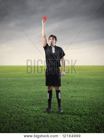 Referee showing a red card