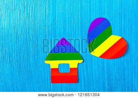 Paper house and heart symbol colors of the rainbow. Homosexual relationships