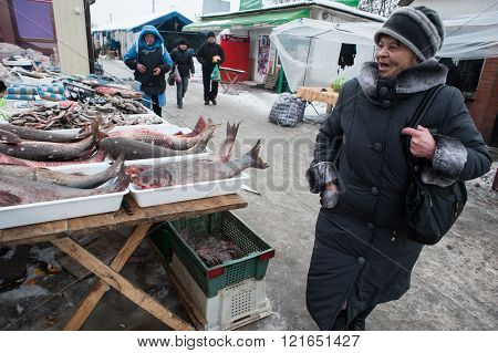 An Elderly Woman Buying Products On The Market.