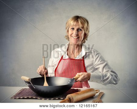 Smiling senior cooking