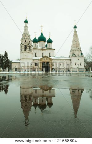 The Church Of Elijah The Prophet or Elias Church with its reflection in the puddle, with retro colors