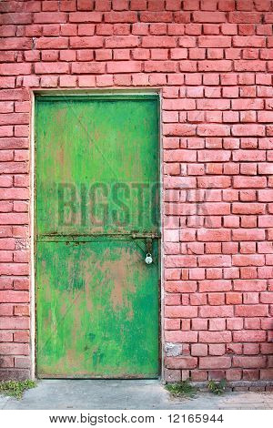Green Door And Brick Wall