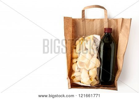 Pasta and olive oil inside a paper bag