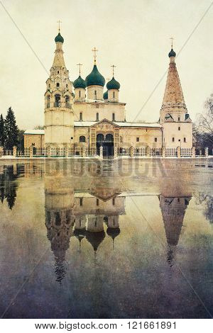 The Church Of Elijah The Prophet or Elias Church with its reflection in the puddle, with postcard style