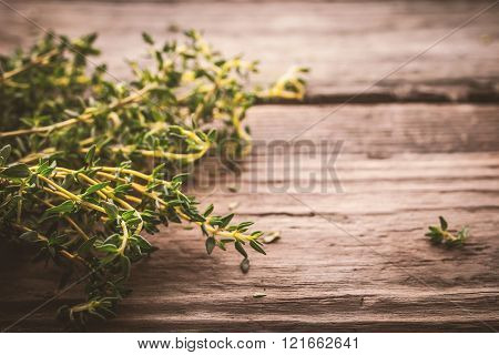 Bundle of thyme on the old wooden board