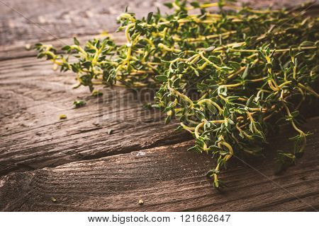 Bunch of thyme on the old wooden board horizontal