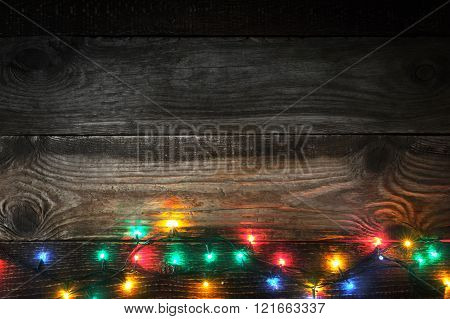 Decoration colorful festoon on the wooden board