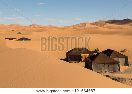 tents in the sand dunes of the desert in Merzouga, Morocco