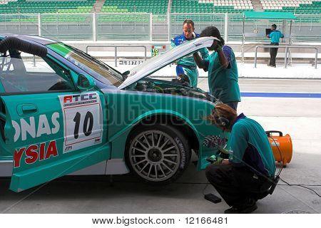 Saloon racecar preparation before race