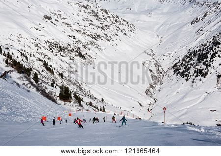 MAYRHOFEN, AUSTRIA :  MARCH 22, 2016:View of  lots of skiers at Mayrhofen Ski resort area with ski lifts, pistes and skiers. Zillertal Alps, Tirol.