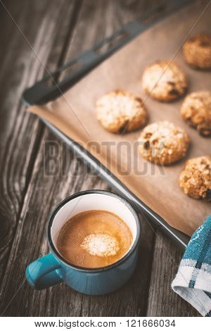 Oatmeal cookies and coffee cup on a wooden table vertical