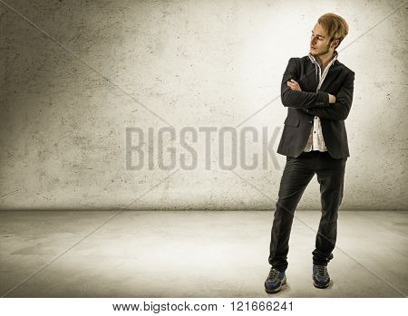 Handsome young man against brick wall