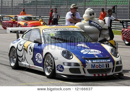 mascot and race car