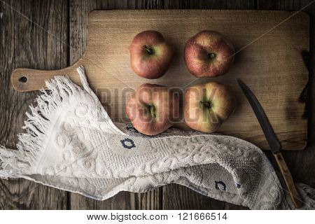 Red apples and towel on the cutting board horizontal