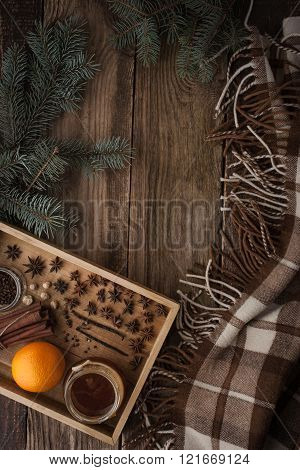 Orange honey and spices on the wooden tray with plaid vertical