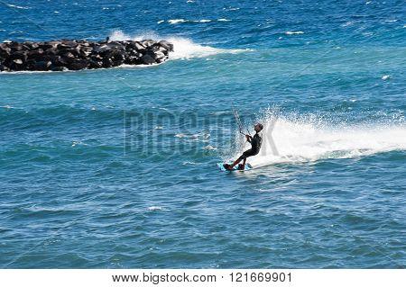 Puerto de Guimar, Tenerife, Spain - December 27 2015: Kite surfing in Puertito de Guimar Tenerife Canary Islands Spain