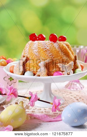 Easter Ring Cake With Cherry Decoration And Icing Sugar