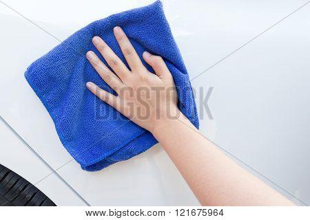 Concept of female clean car using microfiber cloth