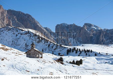 Old church in Dolomites Alps on a sunny day, Italy