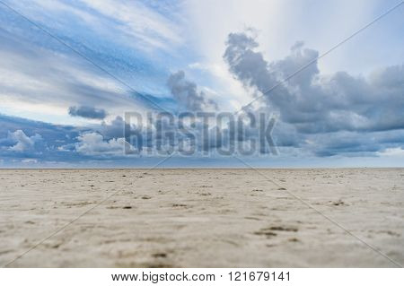 Beach With Stormy Clouds And Solitary Beach