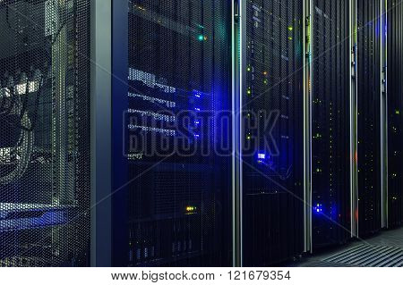 rack with server hardware and lighting in server room