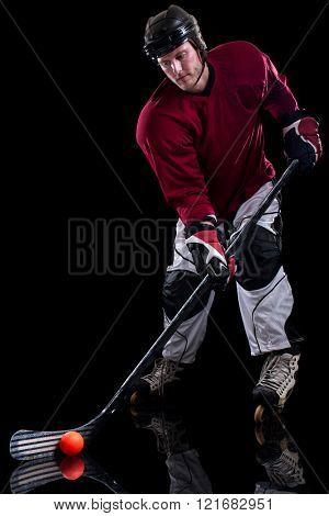 Roller hockey player. Studio shot over black.