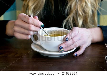 Woman Drink Tea In A Cafe