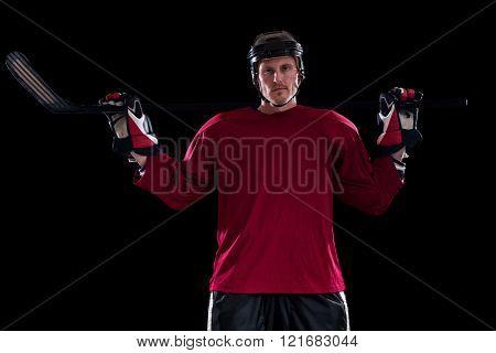 Ice hockey player. Studio shot over black.