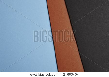 Colored Cardboards Background In Blue Brown Black Tone. Copy Space.