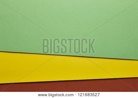Colored Cardboards Background In Green Yellow Brown Tone. Copy Space