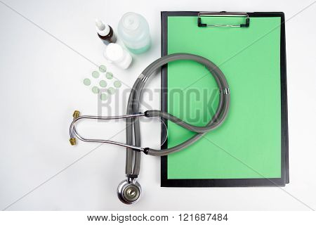 Medical clipboard and stethoscope isolated on white background. Concept of Healthcare And Medicine