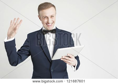 Internet Concept and Ideas. Young Handsome Caucasian Man in Official Suit Using Digital Pad