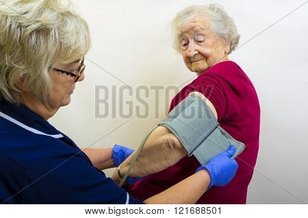 Elderly Lady having Blood Pressure Checked