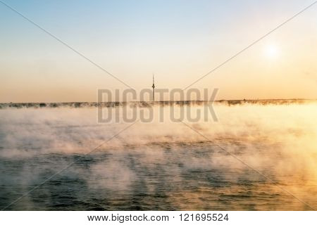 Tallinn. View from the sea to the TV tower in Tallinn at dawn in the fog.January 5 2016. Estonia.