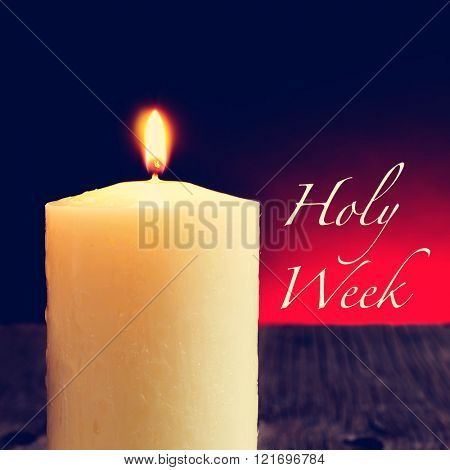 closeup of a lit candle on a rustic wooden surface and the text holy week