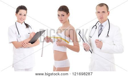 Plastic Surgery And Breast Augmentation Concept - Two Doctors And Beautiful Woman Patient Isolated O