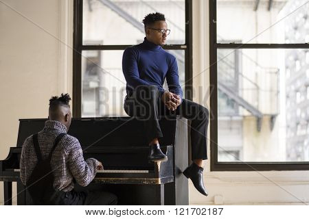 Two afroamerican young man playing piano in a New York studio