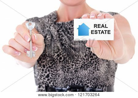 Female Real Estate Agent Hands Holding Key And Visiting Card Isolated On White
