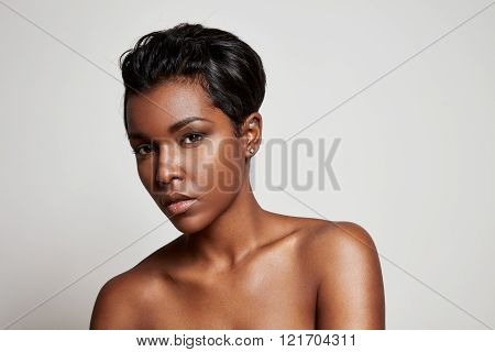 Black Woman With A Short Hair Looking At Camera
